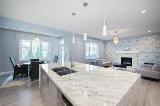 Photo 15: 48 Tremblant Terrace SW in Calgary: Springbank Hill Detached for sale : MLS®# A1131887