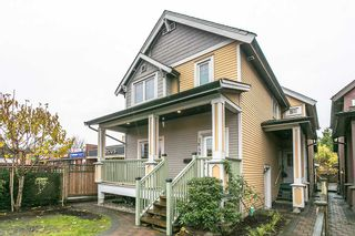 """Photo 1: 1648 E 12TH Avenue in Vancouver: Grandview VE 1/2 Duplex for sale in """"GRANDVIEW WOODLANDS"""" (Vancouver East)  : MLS®# R2222114"""
