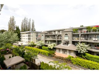 """Photo 1: 306 2373 ATKINS Avenue in Port Coquitlam: Central Pt Coquitlam Condo for sale in """"CARMANDY"""" : MLS®# V1069079"""