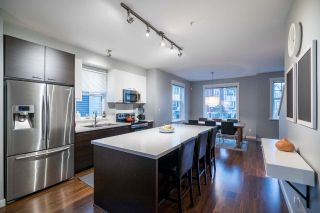 """Photo 2: 124 3010 RIVERBEND Drive in Coquitlam: Coquitlam East Townhouse for sale in """"WESTWOOD"""" : MLS®# R2233937"""