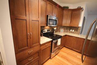 Photo 10: 2101 4 Kingsland Close SE: Airdrie Apartment for sale : MLS®# A1117201