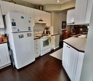 Photo 9: 108 4810 40 Avenue SW in Calgary: Glamorgan Row/Townhouse for sale : MLS®# A1060323