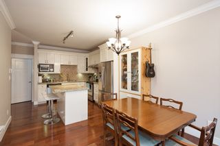 """Photo 5: 101 3333 DEWDNEY TRUNK Road in Port Moody: Port Moody Centre Townhouse for sale in """"CENTREPOINT"""" : MLS®# R2378597"""