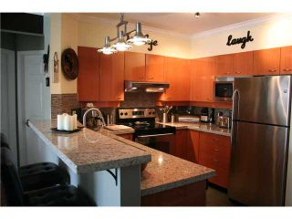 """Photo 4: # 410 3625 WINDCREST DR in North Vancouver: Roche Point Condo for sale in """"WINDSONG 111 @ RAVEN WOODS"""" : MLS®# V930131"""