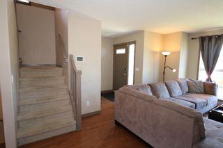 Photo 6: 151 Silverado Drive SW in Calgary: Silverado Detached for sale : MLS®# A1124527