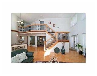 Photo 2: 631 ALDERSIDE RD in Port Moody: House for sale : MLS®# V852913
