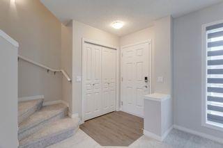 Photo 3: 162 AUBURN BAY Boulevard SE in Calgary: Auburn Bay Semi Detached for sale : MLS®# A1114634