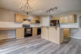 Photo 6: 52 COUGARSTONE Villa SW in Calgary: Cougar Ridge Detached for sale : MLS®# A1020063