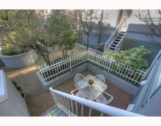 """Photo 1: 5 877 W 7TH Avenue in Vancouver: Fairview VW Townhouse for sale in """"EMERALD COURT"""" (Vancouver West)  : MLS®# v818670"""