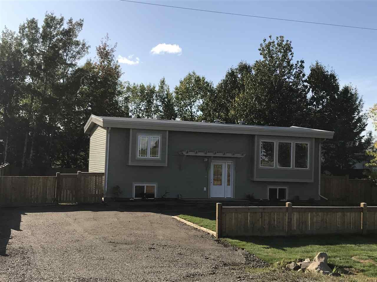 """Main Photo: 10050 257 Road in Fort St. John: Fort St. John - Rural W 100th House for sale in """"AIRPORT SUBDIVISION"""" (Fort St. John (Zone 60))  : MLS®# R2405365"""