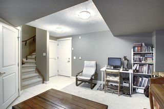 Photo 33: 47 WEST SPRINGS Lane SW in Calgary: West Springs Row/Townhouse for sale : MLS®# A1039919