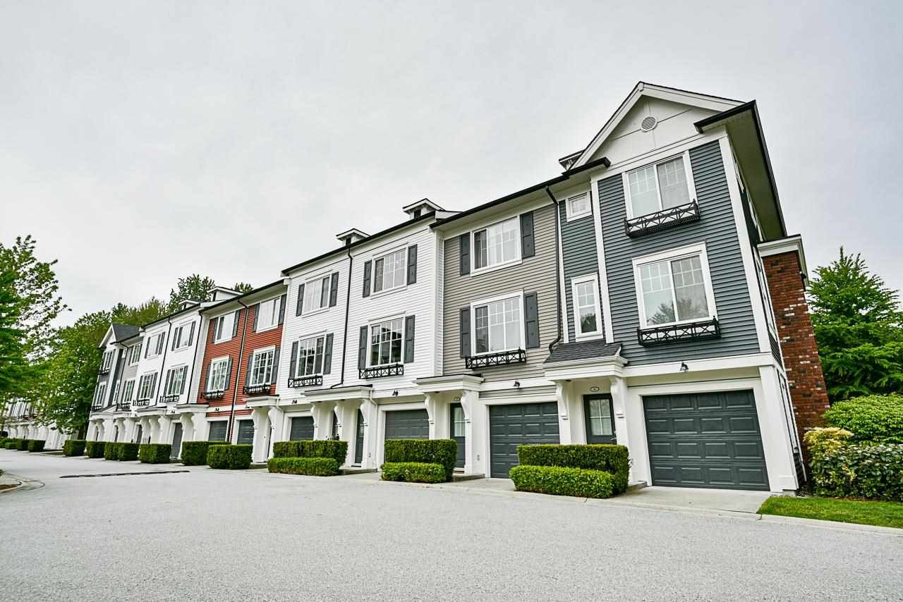 Main Photo: 50 3010 RIVERBEND Drive in Coquitlam: Coquitlam East Townhouse for sale : MLS®# R2578231
