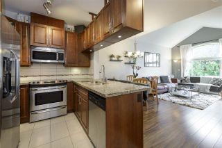 "Photo 1: 404 12525 190A Street in Pitt Meadows: Mid Meadows Condo for sale in ""Cedar Downs"" : MLS®# R2549011"