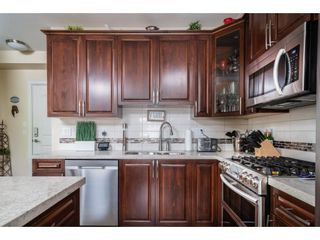 """Photo 5: B226 20716 WILLOUGHBY TOWN CENTRE Drive in Langley: Willoughby Heights Condo for sale in """"YORKSON DOWNS"""" : MLS®# R2455627"""