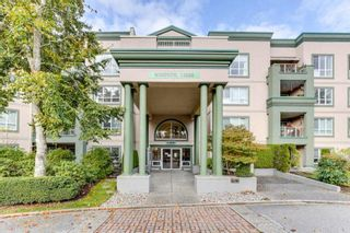 "Photo 3: 322 13880 70 Avenue in Surrey: East Newton Condo for sale in ""Chelsea Gardens"" : MLS®# R2591840"