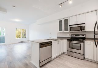 """Photo 3: 218 13958 108 Avenue in Surrey: Whalley Townhouse for sale in """"AURA 3"""" (North Surrey)  : MLS®# R2622290"""