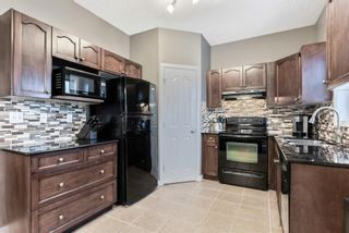 Photo 12: 130 Bishop Crescent NW: Langdon Detached for sale : MLS®# A1078277