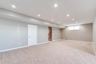Photo 36: 85 Cougar Ridge Close SW in Calgary: Cougar Ridge Detached for sale : MLS®# A1128029