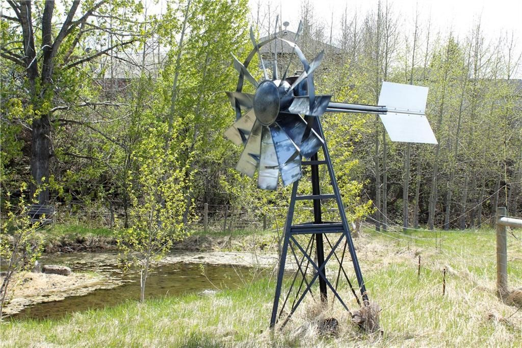 Functioning windmill keeps the spring fed pond aerated.