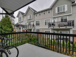 """Photo 7: 102 19932 70 Avenue in Langley: Willoughby Heights Townhouse for sale in """"SUMMERWOOD"""" : MLS®# R2335407"""