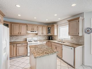 Photo 12: 54 Signature Close SW in Calgary: Signal Hill Detached for sale : MLS®# A1138139