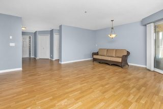 """Photo 7: 310 20120 56 Avenue in Langley: Langley City Condo for sale in """"Blackberry Lane"""" : MLS®# R2564037"""