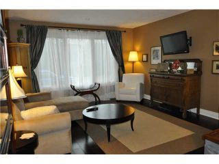 Photo 2: 559 SUMMERWOOD Place SE: Airdrie Residential Attached for sale : MLS®# C3580809