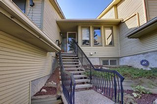 Photo 3: 607 Stratton Terrace SW in Calgary: Strathcona Park Row/Townhouse for sale : MLS®# A1065439