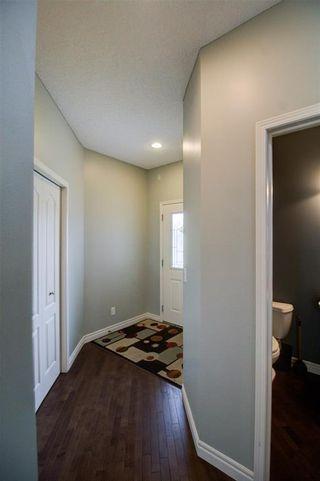 Photo 3: 417 Cimarron Boulevard: Okotoks Detached for sale : MLS®# C4301022