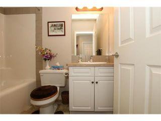 Photo 8: 155 CRAWFORD Drive: Cochrane House for sale : MLS®# C4092224