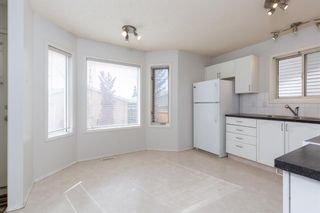 Photo 2: 887 Erin Woods Drive SE in Calgary: Erin Woods Detached for sale : MLS®# A1099055