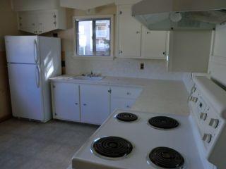 Photo 10: 204 CENTRE Avenue: Cochrane House for sale : MLS®# C4055784