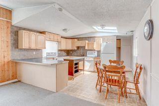 Photo 6: 214 Erin Woods Circle SE in Calgary: Erin Woods Detached for sale : MLS®# A1120105