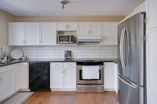 Photo 10: 18 Stradwick Rise SW in Calgary: Strathcona Park Semi Detached for sale : MLS®# A1125011