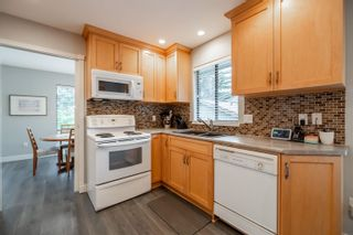 Photo 11: 15027 SPENSER Drive in Surrey: Bear Creek Green Timbers House for sale : MLS®# R2625533
