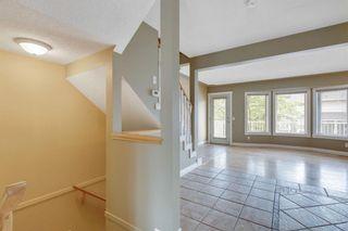 Photo 11: 386 Regal Park NE in Calgary: Renfrew Row/Townhouse for sale : MLS®# A1128007