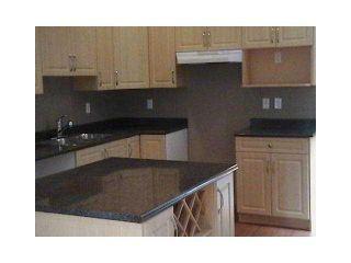 Photo 5: 1988 SANDOWN PL in North Vancouver: Pemberton NV House for sale : MLS®# V1057031