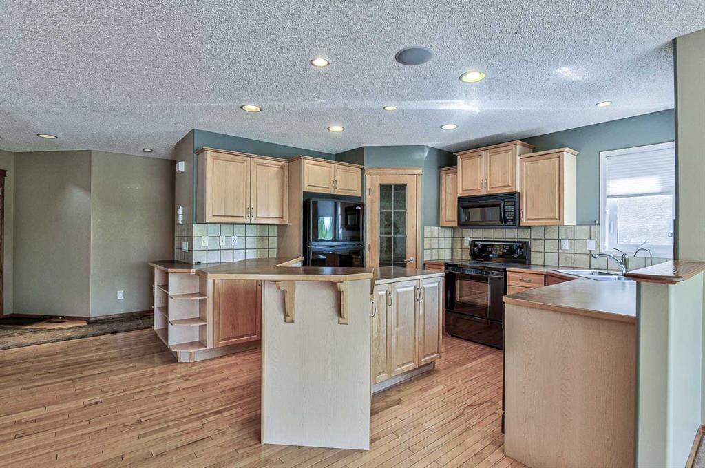 Photo 15: Photos: 106 Everwillow Close SW in Calgary: Evergreen Detached for sale : MLS®# A1116249