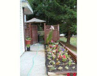 "Photo 1: 101 7064 133B Street in Surrey: West Newton Condo for sale in ""Suncreek"" : MLS®# F2723402"