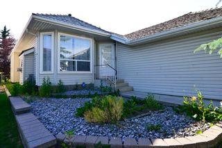 Photo 2: 124 HARVEST PARK Way NE in Calgary: Harvest Hills Detached for sale : MLS®# A1018692
