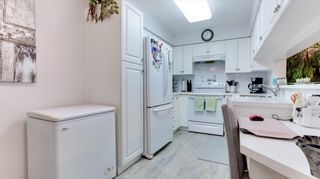 "Photo 10: 322 13880 70 Avenue in Surrey: East Newton Condo for sale in ""Chelsea Gardens"" : MLS®# R2591840"