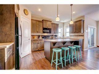 Photo 5: 109 HEARTLAND Way: Cochrane House for sale : MLS®# C4044449