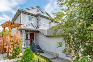 Photo 1: 120 TUSCANY RIDGE View NW in Calgary: Tuscany Detached for sale : MLS®# A1116822