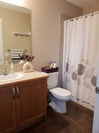 Photo 16: 1402 Clover Link: Carstairs Row/Townhouse for sale : MLS®# A1092269