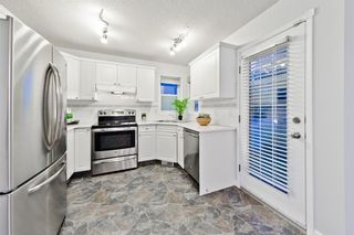 Photo 14: 167 BRIDLEWOOD CM SW in Calgary: Bridlewood House for sale