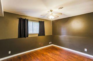"Photo 18: 7387 142 Street in Surrey: East Newton House for sale in ""Nichol Creek Estates"" : MLS®# R2228884"