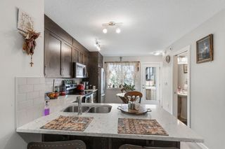 Photo 3: 136 Red Embers Gate NE in Calgary: Redstone Row/Townhouse for sale : MLS®# A1136048