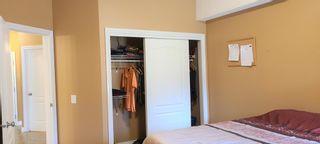 Photo 19: 106 248 Sunterra Ridge Place: Cochrane Apartment for sale : MLS®# A1097518