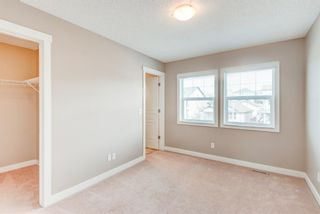 Photo 18: 100 28 Heritage Drive: Cochrane Row/Townhouse for sale : MLS®# A1076913