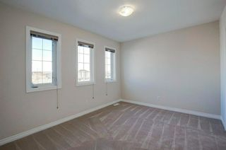 Photo 25: 102 Crestbrook Hill SW in Calgary: Crestmont Detached for sale : MLS®# A1100140